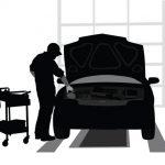 Auto mechanic reparing car
