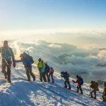 Hikers climbing mountain