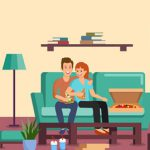 couple eating pizza in front of the TV