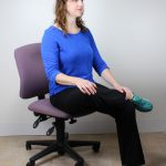Maggie doing seated hip stretch