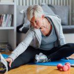 Mature woman exercising at homMature woman exercising at home