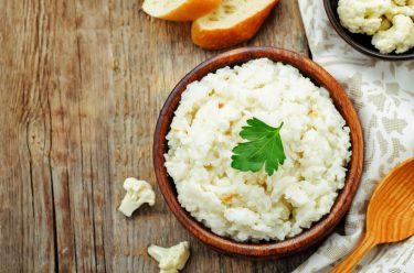 cauliflower riced on wooden table