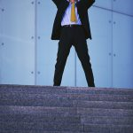 Businessman Raising Arms