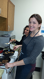 Maggie and Lisa cooking meatless