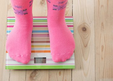 Person in pink socks standing on scale