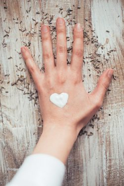 Hand with moisturizer-shaped heart