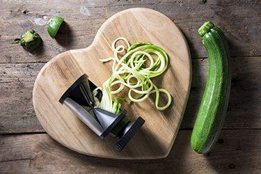 Heart-shaped cutting board with zucchini spiralizer