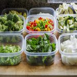 reduce food waste by chopping vegetables into plastic containers