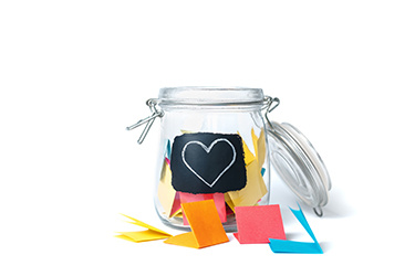 open jar filled with folded notes