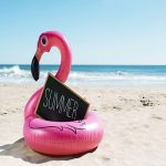 a flamingo swing ring on a beach